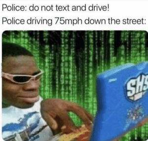 Down The Street: Police: do not text and drive!  Police driving /5mph down the street