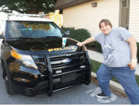Local Hero Puts Jazz Cup On Police Cruiser: POLICE Local Hero Puts Jazz Cup On Police Cruiser
