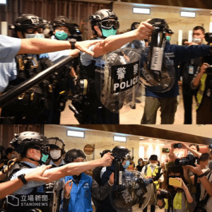Police spaying pepper spray toward the press in Hong Kong's first protest since the pardemic: Police spaying pepper spray toward the press in Hong Kong's first protest since the pardemic
