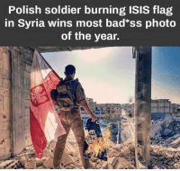 "Does anyone have any more information about this? It seems too cool to be real.: Polish soldier burning ISIS flag  in Syria wins most bad""ss photo  of the year. Does anyone have any more information about this? It seems too cool to be real."