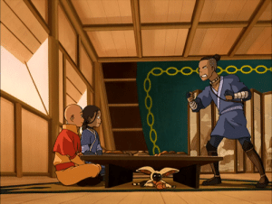 """Food, Love, and Warriors: POOO Love Momo hinding under the table with his food in the """" The warriors of Kyoshi""""."""