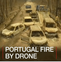 Drone, Fire, and Memes: PORTUGAL FIRE  BY DRONE 20 JUN: Soaring heat in Portugal could reignite a deadly forest fire that has killed at least 64 people in the Pedrogao Grande region, north-east of the capital, Lisbon. Police believe the fires were started by lightning on Saturday during an intense heatwave and rainless thunderstorms. Portugal is observing three days of mourning for the victims. Find out more: bbc.in-portugalfire Fire Heat Portugal BBCShorts BBCNews @BBCNews