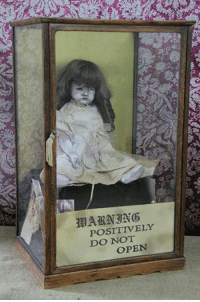Dank, Collective, and Haunting: POSITIVELY  DO OPEN This is Gertrude The Haunted Doll resides in Ed & Lorraine Warrens haunted museum collection. Not as popular as Annabelle but a just as haunted.