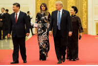 Beijing, Melania Trump, and Memes: President Donald J. Trump walks with China's President Xi Jinping, First Lady Melania Trump, and Xi's wife Peng Liyuan in the Great Hall of the People in Beijing on Thursday.