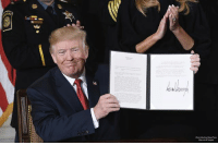 Memes, White House, and House: President DonaldTrump holds a signed presidential memorandum to declare the nation's opioid crises a public health emergency during an event in the East Room of the White House on Thursday.