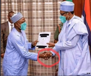 President of Nigeria and the health minister practicing social distancing: President of Nigeria and the health minister practicing social distancing