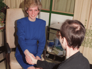 Princess Diana shakes hands with a covid-19 patient without a mask or gloves circa 1987.: Princess Diana shakes hands with a covid-19 patient without a mask or gloves circa 1987.