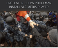 vlc: PROTESTER HELPS POLICEMAN  INSTALL VLC MEDIA PLAYER