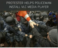 Funny, Helps, and Laughter: PROTESTER HELPS POLICEMAN  INSTALL VLC MEDIA PLAYER 36 Really Funny Photos That Make You Cry With Laughter
