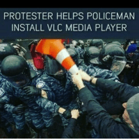 Helps, Kindness, and Media: PROTESTER HELPS POLICEMAN  INSTALL VLC MEDIA PLAYER Random acts of kindness
