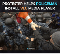 Actually doing something useful!: PROTESTER HELPS POLICEMAN  INSTALL  VLC  MEDIA PLAYER  VIA 8sHIT NET Actually doing something useful!