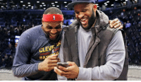 LeBron James checking the score between Warriors and Grizzlies: RA LeBron James checking the score between Warriors and Grizzlies