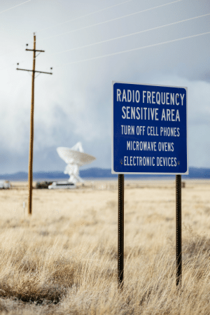 RF warning sign before you enter the Very Large Array in New Mexico: RADIO FREQUENCY  SENSITIVE AREA  TURN OFF CELL PHONES  MICROWAVE OVENS  ELECTRONIC DEVICES RF warning sign before you enter the Very Large Array in New Mexico