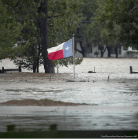 Memes, American, and Texas: Ralph Barrera/Austin American-Statesman via AP The Texas flag flies over floodwaters caused by Tropical Storm Harvey in La Grange, Texas.