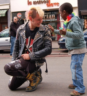"Children, Clothes, and Fucking: RANT  ian  CUISINE FRANPAISE thepunksink:  the-big-phan-theory:  doyounoelyourenemy:  sidvintage:  motherfuckin-pajamas:  deadkennedysandattractivemen:  A punk stops during a gay pride parade to allow a mesmerized child to touch his jacket spikes.  I lost control about reblogging this picture.   and this is the perfect ""fuck you"" to people who stereotype people like this.   literally one of my favourite pictures ever  nothing more punk than letting small children touch your clothes spikes or hair spikes  If you think punks would miss the opportunity to be a good fucking human to kids you don't know much about punks"