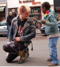 """Omg, Saw, and Taken: RANT  ian  CUISINE FRANPAISE your-heart-dies:  kidswithhats:  afterlifetimes:  thegunstheysell:  motherfuckin-pajamas:  deadkennedysandattractivemen:  A punk stops during a gay pride parade to allow a mesmerized child to touch his jacket spikes.  I lost control about reblogging this picture.  and this is the perfect """"fuck you"""" to people who stereotype people like this.  You guys. I think I was there for this. I think I saw this picture taken. This is really exciting.  this is the cutest thing ever, omg uwu  reblogginggg"""