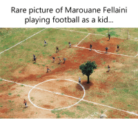 😅😂: Rare picture of Marouane Fellaini  playing football as a kid... 😅😂