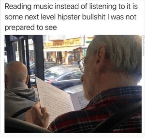 peculiar: Reading music instead of listening to it is  some next level hipster bullshit I was not  prepared to see peculiar
