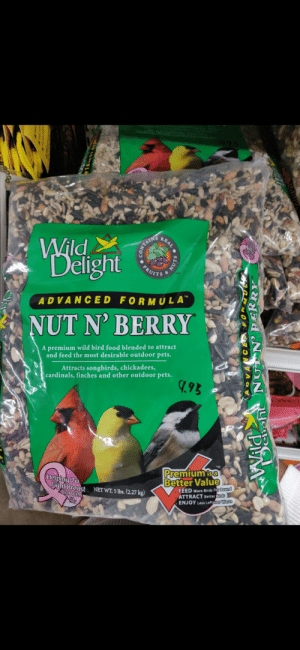 """Food, Birds, and Breast Cancer: REAL  Wild  Delight  FRUITS  TM  ADVANCED FORMULA""""  NUT N' BERRY  A premium wild bird food blended to attract  and feed the most desirable outdoor pets.  Attracts songbirds, chickadees,  cardinals, finches and other outdoor pets.  9.9B  Premium  Better Value  isa  (Helping To  Fight Breast  Cancer  FEED More Birds Per Pound  ATTRACT Better Birds  ENJOY Less Leftover Waste  NET WT. 5 lbs.(2.27 kg)  back jor  IVIN  NUTS  ADVANCED FORMT  NUTN P ERRY Forbidden trail mix"""