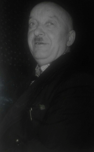 Recently surfaced photo of Adolf Hitler, allegedly taken during an underground poker game/scotch tasting somewhere outside of Buenos Aires. (~1957): Recently surfaced photo of Adolf Hitler, allegedly taken during an underground poker game/scotch tasting somewhere outside of Buenos Aires. (~1957)