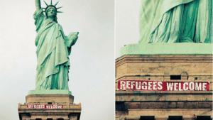 zoekravitzgirlfriend:banner hung on the statue of liberty this afternoon by activists: REFUGEES WELCOME  REFUGEES WELCOME zoekravitzgirlfriend:banner hung on the statue of liberty this afternoon by activists