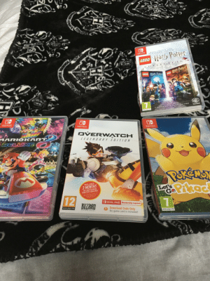 My Nintendo Switch games that I have so far: REMA STERE D FOR  NINTENDO SWIT CH  SWITEA  LEGO Harty Potter  O N  C OLLECTI  7  LEGO ury Patter  YEARS  S  EGO H  LEGO Hlurn Patter eo Paltet  WB  GAMES  2 CLASSIC GAME S ON 1 GAME CARD  www.pegi.info  NINTEN DO  SWITCH  OD  NINTENDO  SWITCH.  NINTEN DO  SWITCH  OVERW ATCH  MARIO KART  DELUXE O  LEGENDARY EDIIION  INCLUDES  3 MONTHS  OF NINTEND0  SWITCH ONLINE  LePikad  Let's  Go  One  Cat 3.month o Nn  12  O URNG  N Bwich  ODONLINE Membership required  BILZZARD  www.pegi.info  Download Code Only  No game card is included!  ENTERTAINMENT  www.pegi.info  NUN My Nintendo Switch games that I have so far