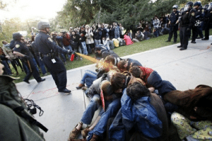 Reminder that UC Davis paid >$100,000 to have this picture removed from the internet. No amount of money will let us forget the Pepper Spray Incident.: Reminder that UC Davis paid >$100,000 to have this picture removed from the internet. No amount of money will let us forget the Pepper Spray Incident.