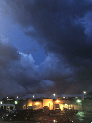 Taking the trash out at work and saw the clouds turning 10 shades of blue.: RENTALS  UNLIMITED Taking the trash out at work and saw the clouds turning 10 shades of blue.