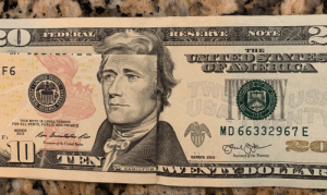 United, Usa, and United States: RESERVE NOTE  FED  THE  DST  10  10  10  10  F 6  1 0  10 10  TW  USA  1ofo 1o  UNITED  10  USA  NTS  1o10  RESERVE  10  10  THIS NOTE IS LEGAL TENDER  FOR ALL DEBTS, PUBLIC AND PRIVATE  SERIES  2013  MD 66332967 E  Raa Bomateteo kis  F2  D  Treasurer of the United States  Secretary of the Treasuy.  SERIES 2013  WAWIH PSSE  ENAY DOLIA -  MUKHNG  HAMILTON  AWAO  STATES  LL  SYSTEM A folded Hamilton $10 + a Jackson $20 = The Hottest Founding Father Ever!