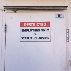 A sign on the back of a local restaurant.: RESTRICTED  EMPLOYEES ONLY  OR  SCARLET JOHANSSON A sign on the back of a local restaurant.