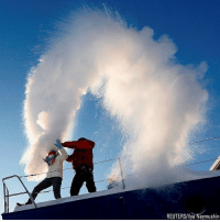Memes, Reuters, and Russia: REUTERS/Ilya Naymushirn People throw hot water into the air, with the air temperature at about minus 29 degrees Fahrenheit, outside Krasnoyarsk, Russia.