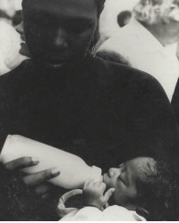 Memes, 🤖, and Fed: rge Tupac getting fed as a baby by his mom. Classic moment. Rest in peace. 🙏