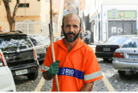 """Dank, Brazil, and Schizophrenia: RIO  PREFETURA """"I met my wife when I was seventeen.  I didn't want to tell her about my schizophrenia.  At the time, she liked another guy who had no issues and I didn't want to ruin my chances.  I hid the disease for a long time after we married.  I would always find explanations for my strange behavior.  I'd make up stories to explain my violent outbursts at work.  But it got to be too much.  By the time I admitted my disease, it was too late.  She got a restraining order a year ago.  I had an outburst and I hit her.  She has forgiven me for the sake of our children, but they don't live with me anymore.  I'm on five strong medications now.  I still have some difficulty controlling the pace of my thoughts.  Some thoughts will begin before others end.  It's like my mind is divided.  It can be tough to keep both feet in reality.  But I don't want any more problems.  I've detached myself from everyone.  I don't speak at work.  I spend my time alone.  It's my only way to live a normal life.""""      (Rio de Janeiro, Brazil)"""