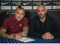 Roma midfielder Radja Nainggolan has signed a new four-year contract with the club.: ROMASO  Cares  Cares  Care  ASROMA.coM  SROMA.COM  OMA.coM  AS RO  0 Roma midfielder Radja Nainggolan has signed a new four-year contract with the club.