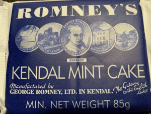 My director Leanne (to whom I gifted the complicated burger crisps) has given me this gift as a palette cleanser. It is incredible. https://t.co/7uNrGhHbAW: ROMNEY'S  O  MNE  GEORC  OEBWENTNS  KENDALCASTLERUINS  ROMNEY HOUSE KENDA  AINE CENDAL TS  INDERMERE  AL  EVEREST  KENDAL MINT CAKE  Manufactured by  GEORGE ROMNEY, LTD. IN KENDAL.to the English  MIN. NET WEIGHT 85g  Lakes My director Leanne (to whom I gifted the complicated burger crisps) has given me this gift as a palette cleanser. It is incredible. https://t.co/7uNrGhHbAW