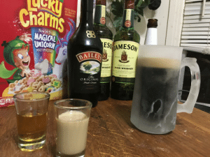Starting early. Unrelated cereal.: ROSTED TOASTED  AT CEREAL WIT  Chat'ims  CB  Now With  MAGICAL  UNICORN  MARSHMALONS  ESO MAMESON  BAILEX  WHISKEYIRISH WHISKEY  BLE N  DISTILLED MATURED& BOTTLED IN IRELAND  IMPORTED  PORTED  ORIGINAL  PER 3/4 CUP SERV Starting early. Unrelated cereal.