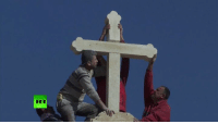 Kurdish militias & locals replace cross destroyed by ISIS atop Christian church near Mosul  READ MORE: http://on.rt.com/7vkq: RT Kurdish militias & locals replace cross destroyed by ISIS atop Christian church near Mosul  READ MORE: http://on.rt.com/7vkq