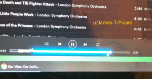 The progress bar in Spotify changes to a lightsaber when you're listening to Star Wars music.: s Death and TIE Fighter Attack - London Symphony Orchestra  3:54 II  Little People Work - London Symphony Orchestra  4:08 III  u/James-T-Picard  eue of the Princess- London Symphony Orchestra  4:48 II  5:24  4:14 F  Star Wars: Der Aufst...  %3D The progress bar in Spotify changes to a lightsaber when you're listening to Star Wars music.