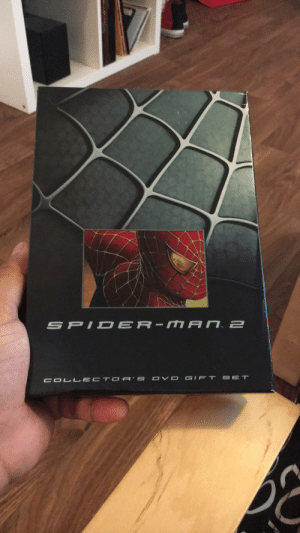 Spider, SpiderMan, and Book: S PID ER- MAn 2  SET  COL LECT OR S OV D GIFT Found at my look record store. It contains the DVD, bonus DVD, concept art booklet, samples of alternate movie posters, and a copy Spider-Man No More comic book.