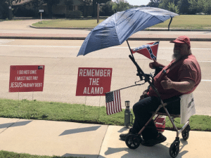 Just outside a church in Allen, TX. MAGA hat... check. Confederate flag... check. Come and take it flag... check. Remember the Alamo sign... uhh. I do not owe, I must not pay, Jesus paid my debt sign... whaaa?: S  RELIEF  I DONOT OWE  I MUST NOT PAY  JESUS PAIDMY DEBT  REMEMBER  THE  ALAMO  KEIT Just outside a church in Allen, TX. MAGA hat... check. Confederate flag... check. Come and take it flag... check. Remember the Alamo sign... uhh. I do not owe, I must not pay, Jesus paid my debt sign... whaaa?