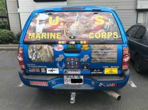 This entire truck is covered in stickers.: SA  CORPS  MARINE  ARMY  RETIRED  I am a GRUNT  I am bound by an oath;  Taken of my own free will  I ama willing servant of my  nations people.  I will protect, defend and fight  In their defense  I will do what others will not:  I will go where others fear to  tread.  RIELEMAN'S CREED  AREA 15  This is my rifle. There are many like it, But this one is mine  AR 15 ACCESSORIES, COATINGS& AMMO  AREA-15.COM 480-832-9796  CIESE  COLORS  RU  NEVER  My rifle is my Best friend. It is my life.I must master it as I must master my life  My rifle, without me is useless. Without my rifle,I am useless. I must fire my rifle  true. I must shoot straighter than my enemy who is trying to kill me. I must shoot him  Before he shoots me.I will.  I will forego my own safety and  comfort;  I will knowingly put myself in  harms way.  I will bring down upon my  Myrifle and I know that what counts in this war is not the rounds we fire, the noise of  our Burst, nor the smoke we make. We know that it Is the hits that count. We will hit  enemy.  FThe full weight of my nations  WTath and resolve.  And though I do know fear and  pain.  My commitment to mission will  transcend these mental  obstacles.  I will be my brother's keeper.  And he will be mine.  I will never surrender,  I will never quit,  I will continue to fight until  victory is achieved,  Or I draw my last breath...  l am a GRUNT  My rifle is human even as L, Because it is my life. Thus, I will learn it as a Brother I will  learn its weaknesses, its strength, Its parts, its accessories, its sights and its Barrel  will keep my rifle clean and ready, even as I am clean and ready. We will Become part  of each other We will..  Before God. I swear this creed. My rille and I are the detenders of my country. We are  the masters of our enemy. We are the saviors of my life.  FOREIGH  So be it, until victory is America's and there is no enemy, tbut peace!  -Doc  COMBAT  VETERANT  (56  TOYOTA  TACOMA 