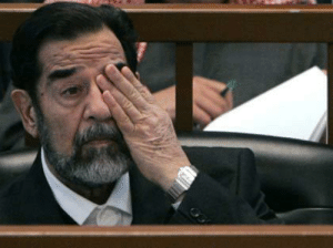Test, Saddam Hussein, and Eye: Saddam Hussein passes his eye test (2005)