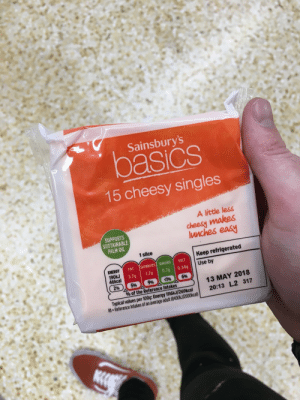 Energy, Ed Sheeran, and Fat: Sainsbury's  pasics  15 cheesy singles  SUPPORTS  SUSTAINABLE  PALM OIL  A litte less  cheesy makes  unches easy  1 slice  Keep refrigerated  ENERGY  FAT İSATURATESİ SUGARS! SALT  Use by  46kcal  3.7g 1.7g 0.7g 0.34g  2% ) 596 996 196 696  % of the Reference Intakes  13 MAY 2018  20:13 L2 317  Typical values per 100g: Energy 1116  Rl-Reference Intakes of an average adult (8400kJ/2000kcal) Just picked up Ed Sheerans new album