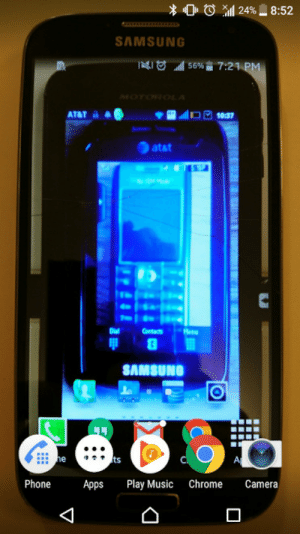 Chrome, Music, and Phone: SAMSUNG  atat  S.:a  SAMSUNG  ts  Phone Apps Play Music Chrome Camera Phoneception - Whenever I upgrade my phone I snap a pic of the old phone with this photo as the background. I find it pretty amusing but my wife hates it.