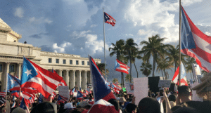 Time, Step, and One: SDAD  d  Cuards la tiran  RICARDO RO  El pueblo  te puso e  uetbie Peacefully protesting in front of the PR capitol. Letting our voices be heard and toppling the unjust one step at a time. Our island deserves better.