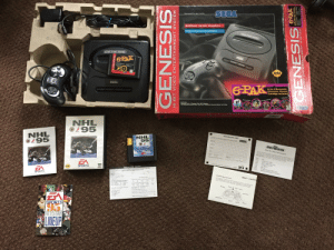 National Hockey League (NHL), Sports, and Game: SECA  6PAK  SEGA  6-In-I Ge  1 Genesls Classaies Game Certridge  NHL  O295  NHL  i95  ISTRATION CARD  NHL  95  SEGA  GENESIS  Order  EA  SPORTS  SPORT  SPORTS  95  LINEUP Was digging around my basement when I found my Dads old Sega Genesis, as well as NHL 96, most of the instruction manuals were still in the box as well