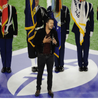 Country music artist Luke Bryan sings the national anthem before SuperBowl 51 between the Atlanta Falcons and the New England Patriots. (AP Photo-Charlie Riedel): SEM  SELF Country music artist Luke Bryan sings the national anthem before SuperBowl 51 between the Atlanta Falcons and the New England Patriots. (AP Photo-Charlie Riedel)
