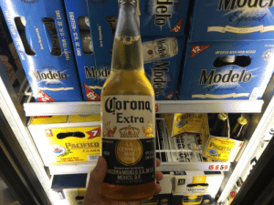 Beer, Mexico, and Corona: Serve Resp  IMPORTED BEER FROM MEXICO  odelo  Modelo  rond  Extra  IN MEXICO  MARC  ACIFICO  CLARA  LA  CERVEZ  MA  IN  BEER  24 FL  Brewed and bottled by  5 659  VECERIA MODEL.A DEC  MEXICO, D.F  REG.SS.A N 7417  Corona