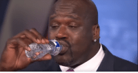 Shaq O'Neal drinking a water bottle: Shaq O'Neal drinking a water bottle