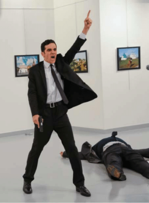 """Assassination, Police, and Tumblr: sixpenceee:  A Turkish police officer who angrily denounced the bloodshed in Syria killed the Russian ambassador to Turkey in Ankara on Monday, shooting the diplomat in front of a room full of horrified spectators at an art gallery in an assassination captured on video and quickly shared around the world.As the ambassador, Andrei Karlov, lay on the floor, the assailant, still waving his gun, screamed, """"Don't forget Aleppo! Don't forget Syria!"""" The shooting was among the most brazen retaliatory attacks yet on Russia since Moscow entered the war in Syria on the side of President Bashar al-Assad, and unleashed a bombardment on Aleppo that has drawn international condemnation for what observers on the ground have called indiscriminate attacks on civilians. (Source)"""